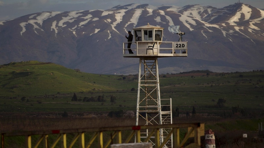 March 8, 2013: A U.N. peacekeeper from the UNDOF force stands guard on a watch tower at the Quneitra Crossing between Syria and the Israeli-controlled Golan Heights.