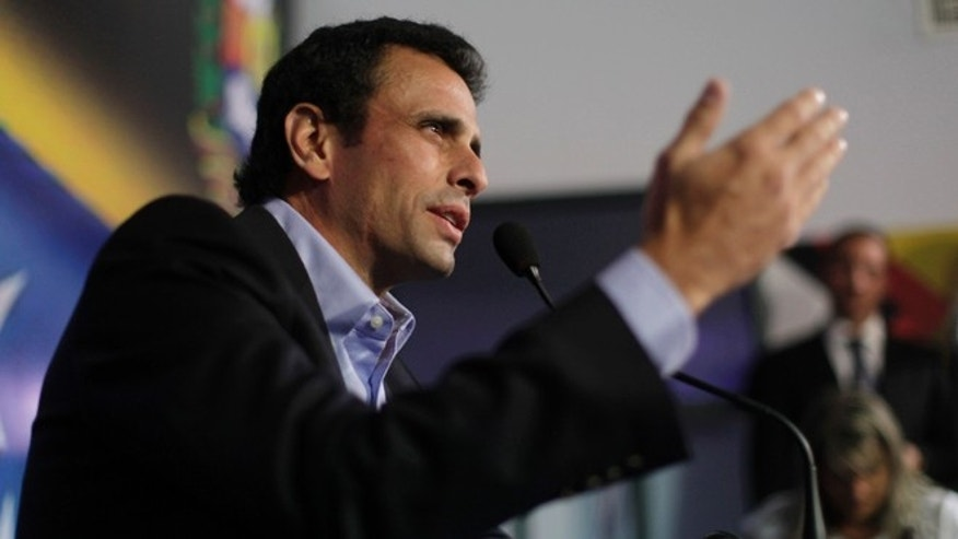 Opposition leader Henrique Capriles speaks during a press conference in Caracas, Venezuela, Friday, March 8, 2013.
