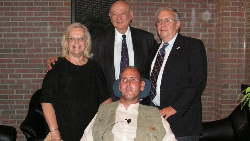 Steven Averbach, shown here with his parents, Maida and David, and former New York City Mayor Ed Koch, was left paralyzed from the neck down after he tried to stop a suicide bomber in Jerusalem.