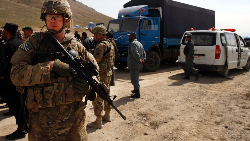 March 11, 2013 - A U.S. soldier secures the scene after U.S. forces shot on an Afghan truck on the road between Kabul and Bagram, Afghanistan, Monday.