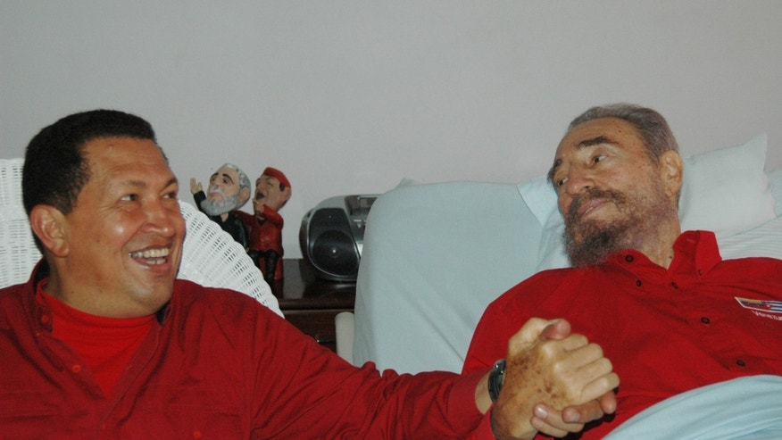 Aug. 13, 2006 - FILE Cuba's leader Fidel Castro, right, and Venezuela's President Hugo Chavez hold hands as Castro recuperates from surgery in Havana, Cuba.
