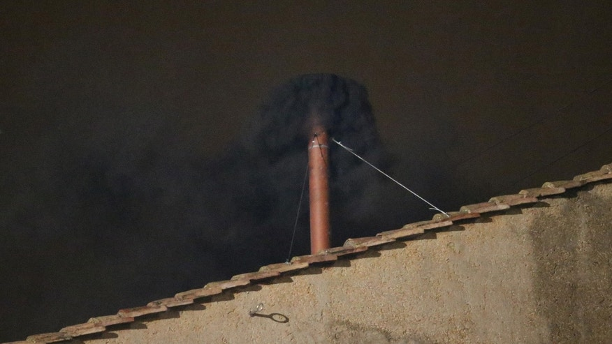 VATICAN CITY, VATICAN - MARCH 12:  Black smoke billows out from a chimney on the roof of the Sistine Chapel indicating that the College of Cardinals have failed to elect a new Pope on March 12, 2013 in Vatican City, Vatican. Pope Benedict XVI's successor is being chosen by the College of Cardinals in Conclave in the Sistine Chapel. The 115 cardinal-electors, meeting in strict secrecy, will need to reach a two-thirds-plus-one vote majority to elect the 266th Pontiff.  (Photo by Peter Macdiarmid/Getty Images)
