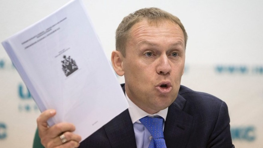 March 12, 2013: Andrei Lugovoi holds papers he which he said he got from Scotland Yard, during press conference in Moscow, Russia,  about the 2006 poisoning of former Russian agent turned Kremlin critic Alexander Litvinenko in London.