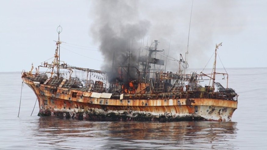 April 5, 2012: In this photo provided by the U.S. Coast Guard, a plume of smoke rises from the derelict Japanese ship Ryou-Un Maru after it was hit by canon fire by a U.S. Coast Guard cutter in the Gulf of Alaska. The Coast Guard decided to sink the ship dislodged by last year's tsunami because it was a threat to maritime traffic and could have an environmental impact if it grounded. (AP/U.S. Coast Guard)