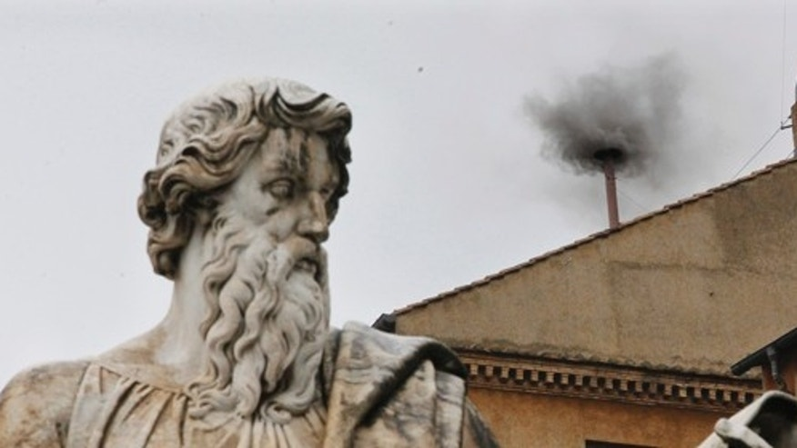 Black smoke emerges from the chimney on the Sistine Chapel as cardinals voted on the second day of the conclave to elect a pope in St. Peter's Square at the Vatican, Wednesday, March 13, 2013. In the foreground is the statue of St. Paul. (AP Photo/Dmitry Lovetsky)