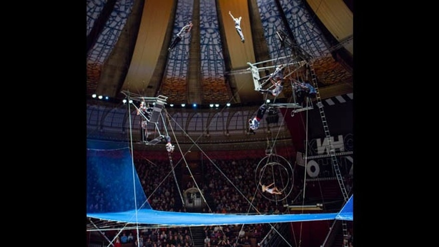 Friday, March 1, 2013: In this photo provided by The Great Moscow State Circus on Thursday, March 14, 2013, a group of acrobats, one of them, Karo Christopher Kazungu performs during a premiere show at The Great Moscow State Circus in Moscow. The Great Moscow State Circus said Kazungu fell through a safety net during a show Wednesday night and was rushed to a hospital with severe injuries including a fractured vertebra.