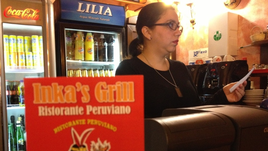 Sheilla Diaz, 35, opened Inka's Grill restaurant in Monte Mario, Rome, two years ago. She says she has lost confidence in the 'men of God' especially because of the pedophilia scandals.