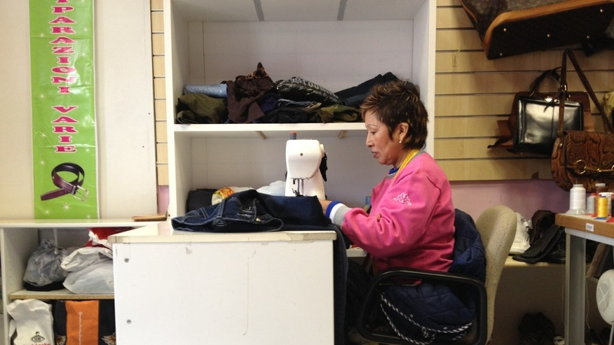 Bertha Llacsa, 50, is a Peruvian immigrant who has lived in Rome's Monte Mario neighborhood for 20 years. She had dreamt of starting her own salon, but is now a seamstress. She hopes a Latino pope can help Rome's immigrant community, and help strengthen the city's religious practices.
