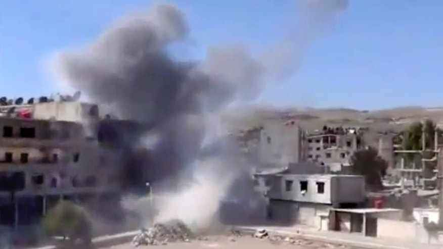 March 14, 2013 - In this image taken from video. smoke rises from buildings due to heavy shelling in Maadamiyeh south of Damascus, Syria.