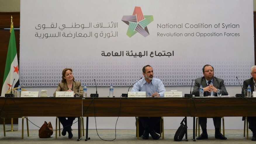March 18, 2013 - Head of the new Syrian National Coalition for Opposition and Revolutionary Forces Mouaz al-Khatib, second left, speaks with other unidentified members, during a meeting in Istanbul, Turkey.