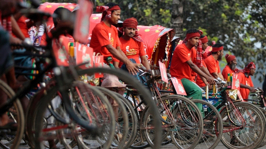 Bangladeshi rickshaw pullers participate in a race in Dhaka, Bangladesh, Friday, March 15, 2013. A total of 84 rickshaw pullers will embark on the race from Jatiya Sangsad Bhaban to Old Dhaka and back during the Dhaka Rickshaw Festival Week. (AP Photo/A.M. Ahad)