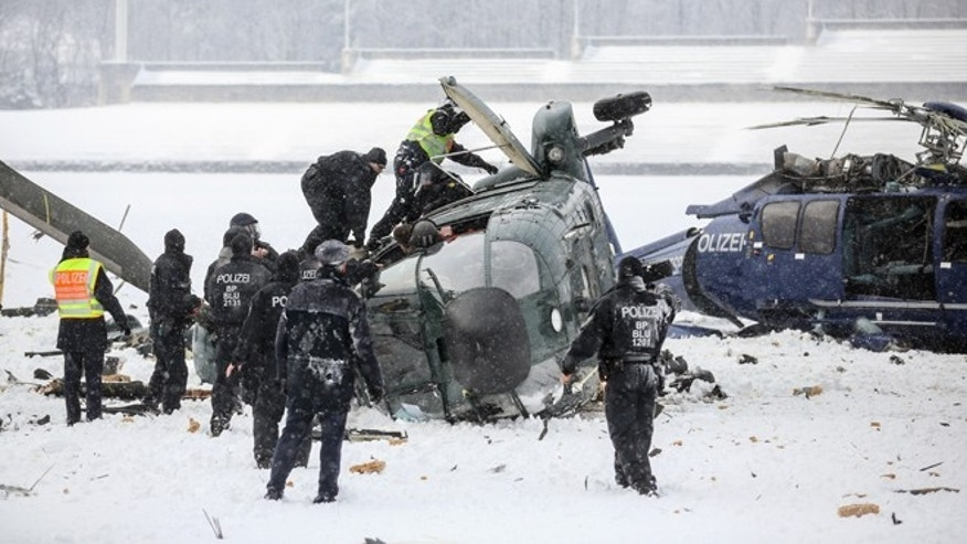 March 21, 2013: Rescue workers examine two crashed helicopters of the German federal police on a field at the Olympic Stadium in Berlin, Germany.