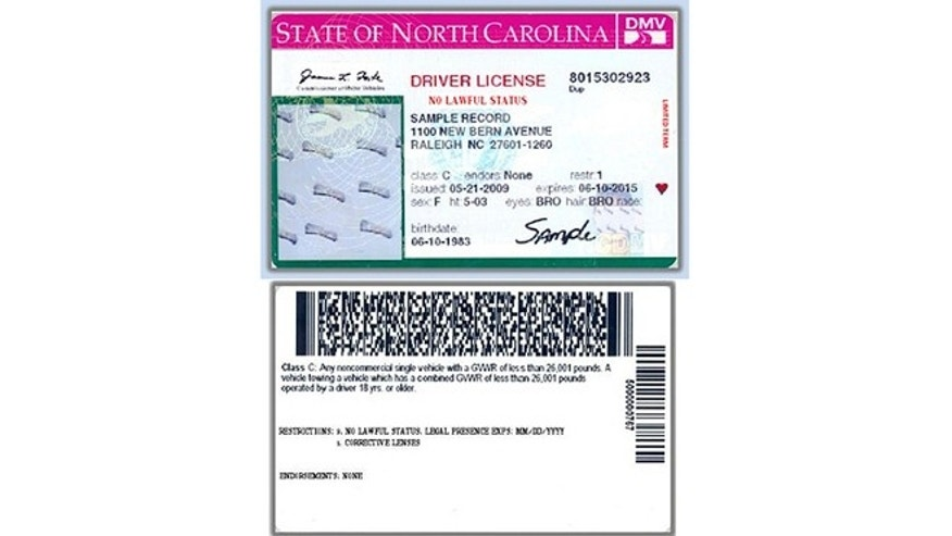 "In this image released by the The North Carolina Division of Motor Vehicles on Friday, Feb. 22, 2013, a new North Carolina driver's license set to be issued to some illegal immigrants has a bright pink stripe and the bold words ""NO LAWFUL STATUS,"" is shown. (AP Photo/North Carolina Division of Motor Vehicles)"