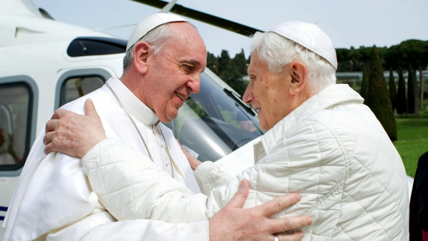 March 23, 2013: In this photo provided by the Vatican paper L'Osservatore Romano, Pope Francis meets Pope emeritus Benedict XVI in Castel Gandolfo.