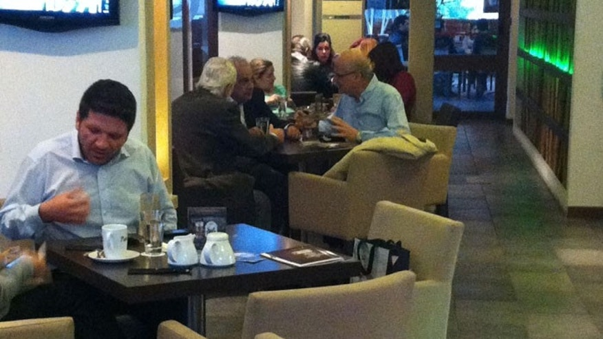 The conversations - and expressions - have turned serious in the coffee shops of Nicosia. (Photo by Shemaine Bushnell)