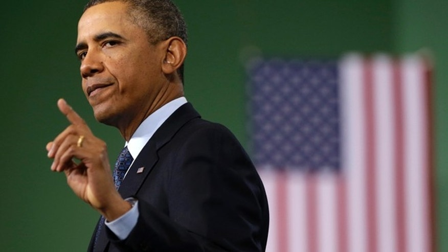 President Barack Obama gestures as he speaks about automatic defense budget cuts during a visit to Newport News Shipbuilding, a division of Huntington Ingalls Industries, Tuesday, Feb. 26, 2103, in Newport News, Va. (AP Photo/Charles Dharapak)