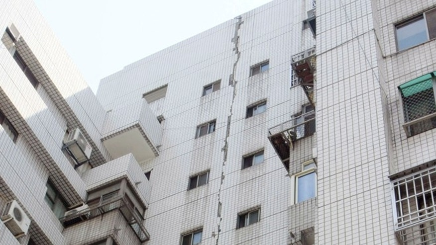March 27, 2013: A large crack lines the entire exterior wall of a building in Taichung, central Taiwan,  following a strong earthquake early in the day. The 6.1 quake struck central Taiwan on Wednesday, killing at least one person and injuring 19 as it damaged buildings on the quake-prone island.