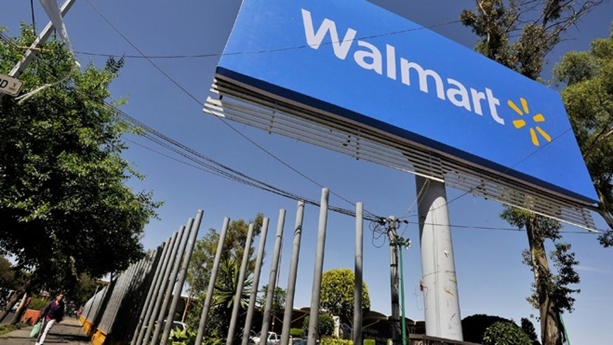 MEXICO CITY, MEXICO - APRIL 23:  Wal-Mart signage is seen in the parking lot of the store on April 23, 2012 in Mexico City, Mexico. According to reports, Wal-Mart de Mexico orchestrated a campaign of bribery to win market dominance by paying bribes to obtain permits in parts of the country. Wal-Mart Inc, along with two U.S. congressmen is conducting internal investigations over the allegations.  (Photo by Daniel Aguilar/Getty Images)