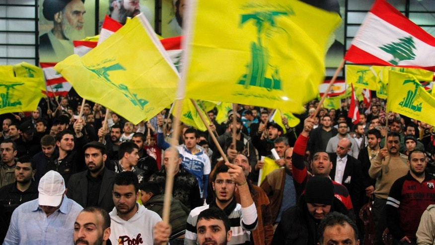 February 16, 2013 - FILE photo: Lebanon's Hezbollah supporters wave flags during a rally to commemorate Martyrs' Day in Beirut.  .