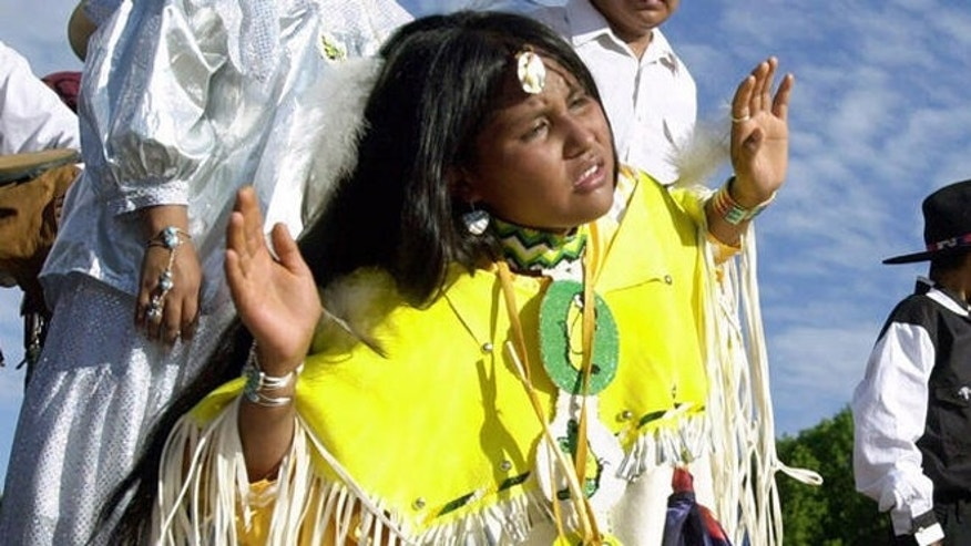 An Apache girl dances at a gathering. The Lipan Apache Tribe of Texas hopes to overturn a federal law that it claims violates the civil liberties and religious freedom of the tribe.