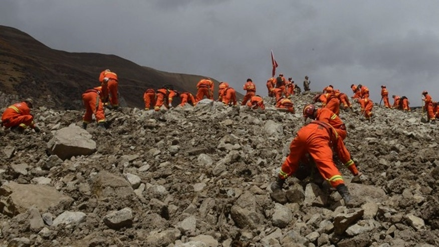 March 30, 2013: In this photo provided by China's Xinhua News Agency, rescue workers conduct search and rescue work at the site where a large-scale landslide hit a mining area in Maizhokunggar County of Lhasa, southwest China's Tibet Autonomous Region. Emergency crews in Tibet slogged through pileups of earth up to 100 feet deep Sunday after a massive mudslide at a gold mine buried 83 workers, and authorities said chances were slim for finding any survivors.