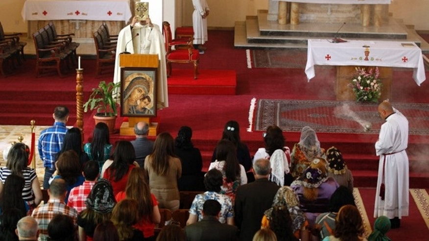 March 31, 2013: Iraqi Christians pray during Easter mass at Mar Youssif Chaldean Church in Baghdad, Iraq. The Chaldean Church is an Eastern Rite church affiliated with the Roman Catholic Church.