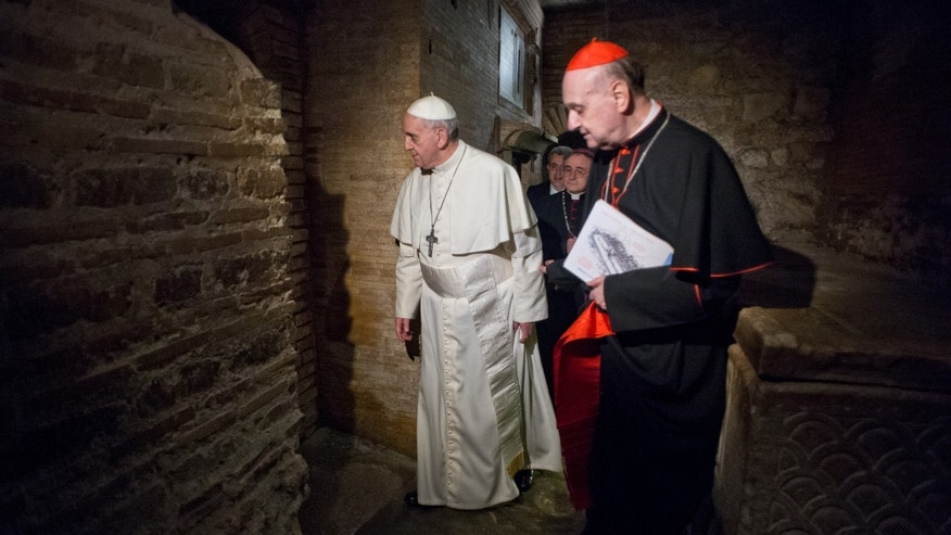 April 1, 2013 - Pope Francis, followed by Cardinal Angelo Comastri, right, and Bishop Vittorio Lanzani, partially hidden, visits the necropolis where pagans and early Christians were buried under St. Peter's Basilica at the Vatican and where St. Peter is believed to be buried.