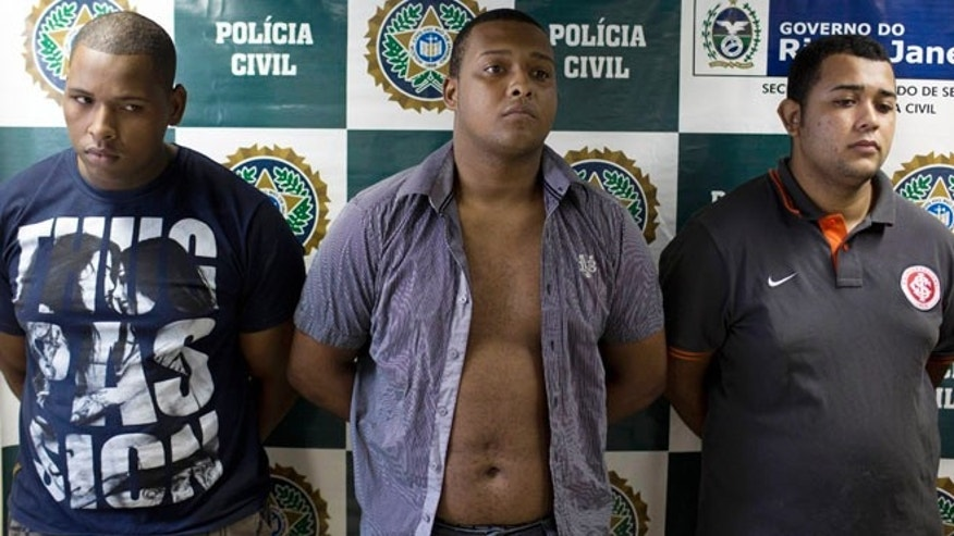 April 2: Suspects Wallace Aparecido Souza Silva, left, Carlos Armando Costa dos Santos, center, and Jonathan Foudakis de Souza are presented to the press at the Special Police Unit for Tourism Support after being arrested for allegedly attacking tourists in Rio de Janeiro.