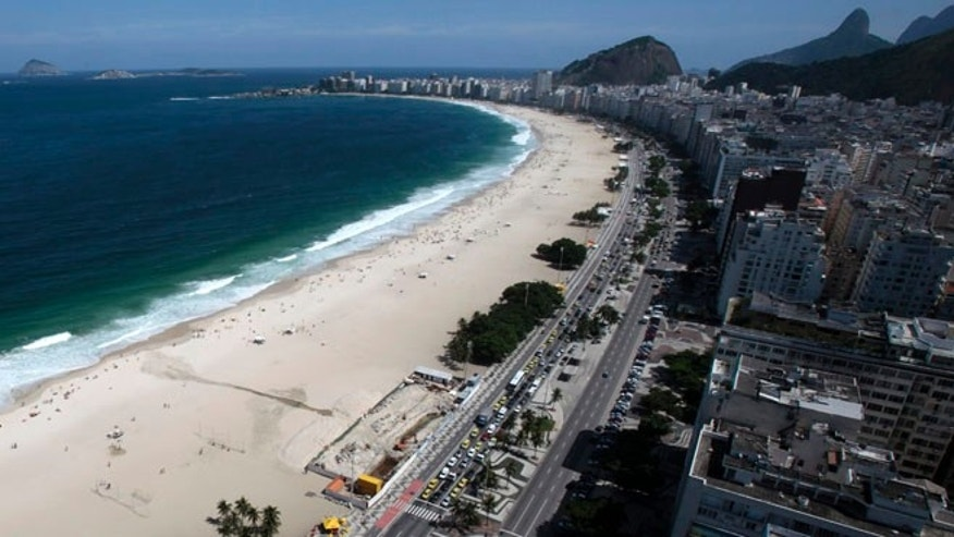 Police said a woman and her companion were brutally assaulted and held for hours aboard a public transport van they boarded in Rio de Janeiro's Copacabana beach neighborhood.