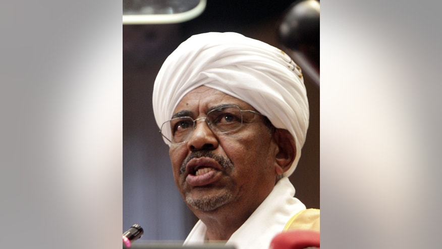 In this Monday, April,1, 2013 photo, Sudanese President Omar al-Bashir addresses Parliament in Khartoum. Sudanese officials say the government has released seven political prisoners, including a female politician, under an amnesty declared by al-Bashir. An unspecified number of politicians, and military and intelligence officers remain in jail accused of plotting to overthrow al-Bashir, who seized power in a military coup in 1989. (AP Photo/Abd Raouf)