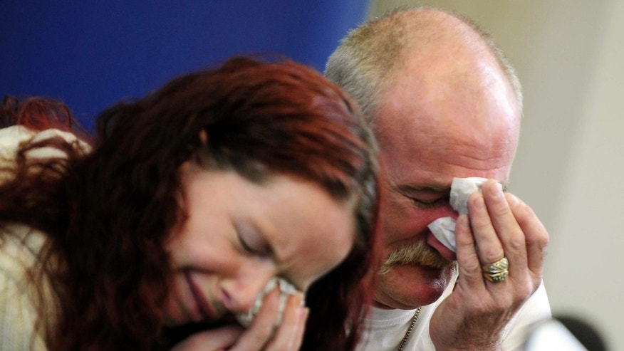 In this May 16, 2012 file photo, Mick Philpott, right, and wife Mairead react during a news conference at Derby Conference Centre following a fire at their home  which claimed the lives of six of his children, Derby, England.  A jury found Mick and Mairead Philpott guilty of the killing of their six  children, aged 5 to 13, in a house fire in Derby, central England, in May 2012. Paul Mosley, a friend of the couple, was also convicted of manslaughter Tuesday April 2 2013.