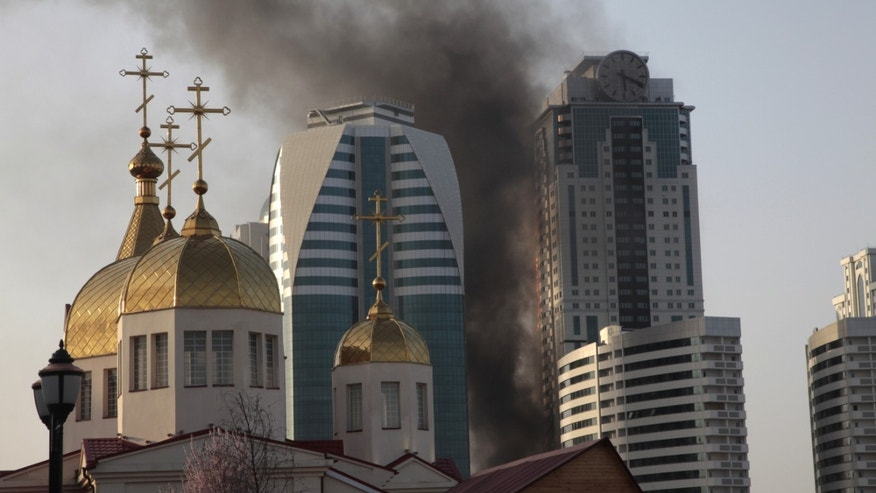 A fire rages in a high-rise apartment building in provincial capital Grozny, Russia, Wednesday, April 3, 2013. French actor Gerard Depardieu reportedly received an apartment in the complex of buildings as a gift from Chechen leader Ramzan Kadyrov.  People are not living in the building yet. (AP Photo/Musa Sadulayev)