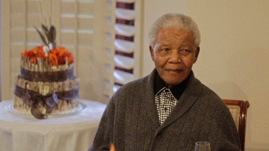 """FILE - In this Wednesday, July 18, 2012 file photo, former South African President Nelson Mandela as he celebrates his 94th birthday with family in Qunu, South Africa.  A South African official says Mandela is breathing """"without difficulty"""" after having a procedure to clear fluid in his lung area that was caused by pneumonia. (AP Photo/Schalk van Zuydam, File)"""