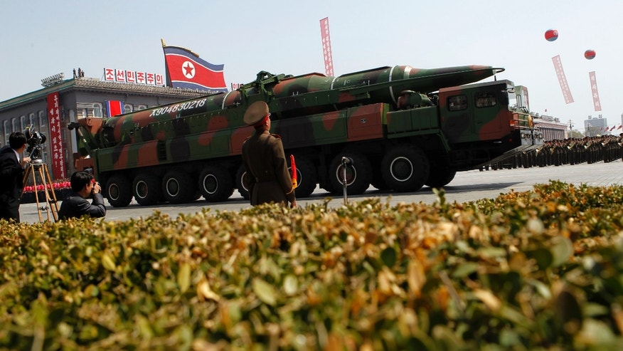 "April 15, 2012: In this file photo, a North Korean vehicle carrying what appears to be a new missile passes by during a mass military parade in Pyongyang's Kim Il Sung Square to celebrate the centenary of the birth of the late North Korean founder Kim Il Sung. North Korea has moved a missile with ""considerable range"" to its east coast, South Korean Defense Minister Kim Kwan-jin said Thursday, April 4, 2013 but he added that there are no signs that Pyongyang is preparing for a full-scale conflict."