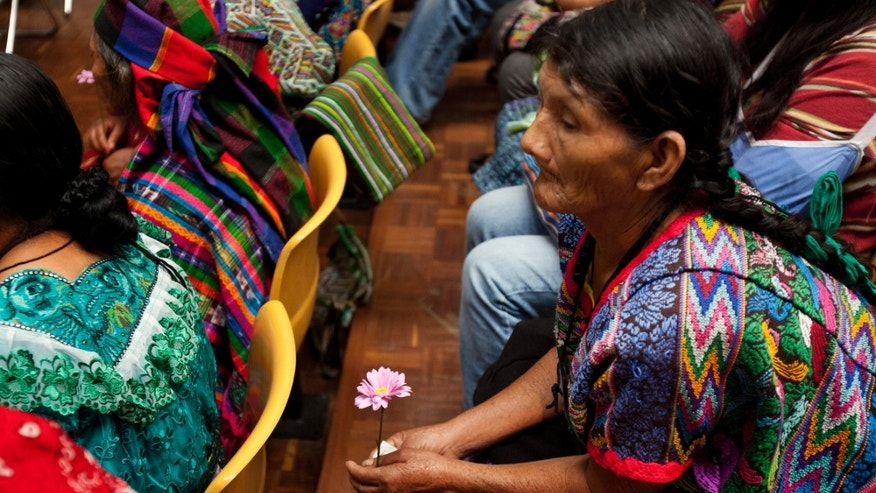Ixil Indian women attend the genocide trial of Guatemala's former dictator Jose Efrain Rios Montt in Guatemala City, Tuesday, April 2, 2013. Rios Montt, the first Latin American strongman to be tried on genocide charges in his own country, seized power in a March 23, 1982, coup, and ruled until he himself was overthrown just over a year later. Prosecutors say that while in power he was aware of, and thus responsible for, the slaughter by subordinates of at least 1,771 Ixil Mayas in San Juan Cotzal, San Gaspar Chajul and Santa Maria Nebaj, towns in the Quiche department of Guatemala's western highlands. (AP Photo/Moises Castillo)