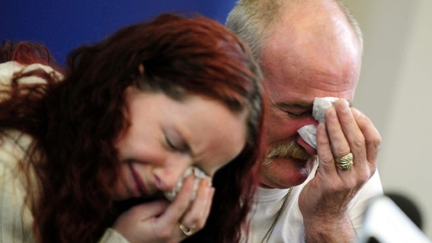 In this May 16, 2012 file photo, Mick Philpott, right, and wife Mairead react during a news conference at Derby Conference Centre following a fire at their home  which claimed the lives of six of his children, Derby, England. A judge sentenced the Mick Philpott father of six children who died in a house fire to a minimum of 15 years in prison Thursday April 4, 2013, after describing him as the driving force behind the blaze.