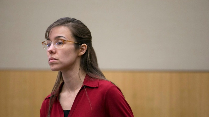 Jodi Arias stands and looks as the jury is excused for the lunch break during her trial at Maricopa County Superior Court in Phoenix on Thursday, April 4, 2013. Arias is charged with murder in the death of lover Travis Alexander. (AP Photo/The Arizona Republic, David Wallace, Pool)