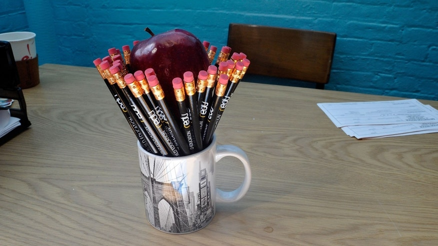 NEW YORK - OCTOBER 09: A view of new pencils and an apple on a desk at the Redu project presented by Bing on October 9, 2010 in New York City.  (Photo by Joe Corrigan/Getty Images for Bing)