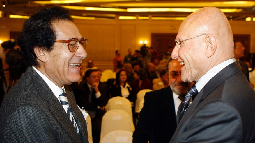 FILE -- In this Sunday, Nov. 16, 2008 file photo, the Lebanese Culture Minister Tammam Salam, right, seen with his Egyptian counterpart Farouk Hosni, during a two-day meeting of Arab culture ministers in Damascus, Syria. Lebanese President Michel Suleiman is scheduled to start Friday, April 5, 2013 two days of consultations with representatives of parliament blocs toward naming a new prime minister. Beirut lawmaker Tammam Salam is emerging as the leading candidate for the post -- although leaning toward the Western-backed anti-Hezbollah coalition, Salam, a former minister of culture, is seen as a consensus figure. (AP Photo Bassem Tellawi, File)