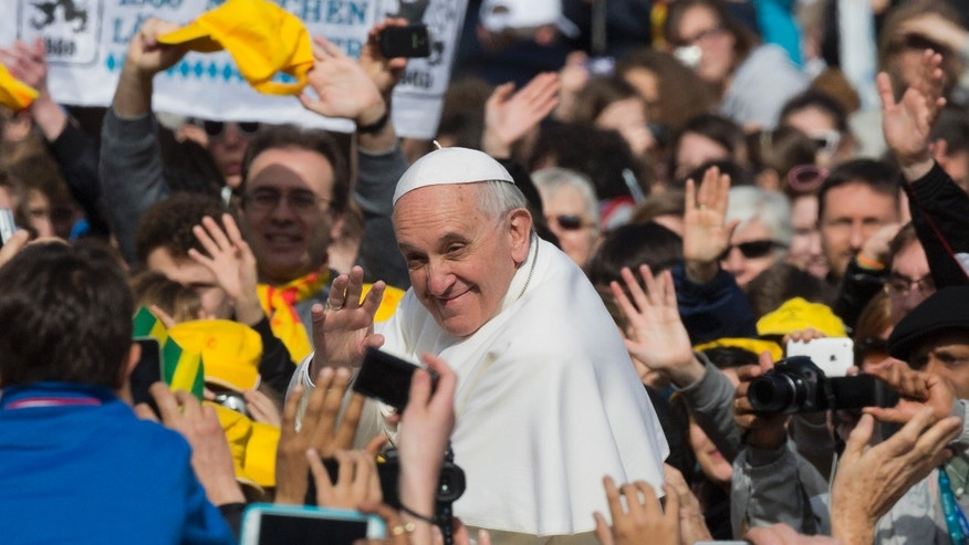 Pope Francis waves as he tours St. Peter's Square at the Vatican in his popemobile prior to his weekly general audience, Wednesday, April 3, 2013. (AP Photo/Domenico Stinellis)
