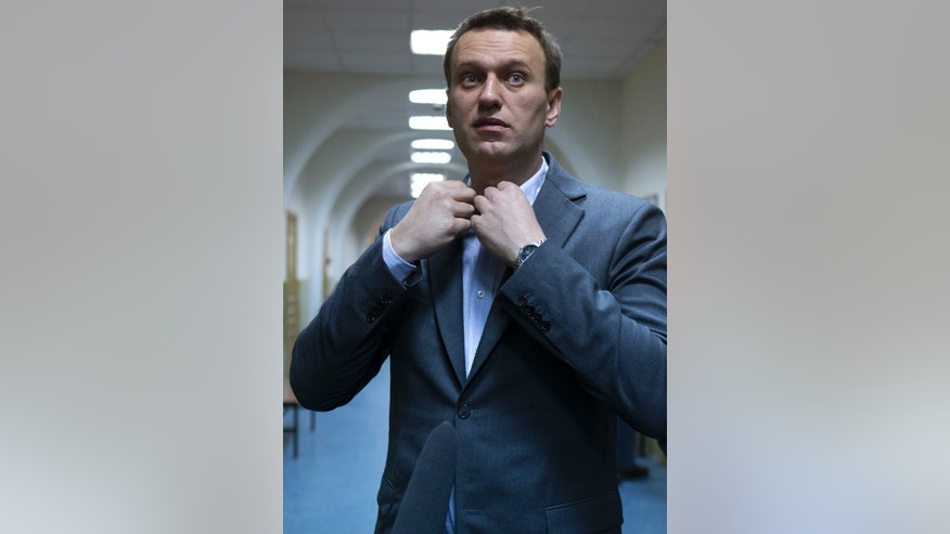 In this photo taken on Wednesday, March 13, 2013, Russian opposition activist Alexey Navalny talks to journalists outside a courtroom in Moscow, Russia. Navalny, a prominent Russian opposition leader says he plans to contest the country's presidential election slated for 2018, and would prosecute President Vladimir Putin if he wins. Navalny, a charismatic 36-year old lawyer, made his name exposing official corruption before spearheading a series of massive protests in Moscow against Putin's return to the presidency in the March 2012 vote for another six-year term. (AP Photo/Alexander Zemlianichenko)