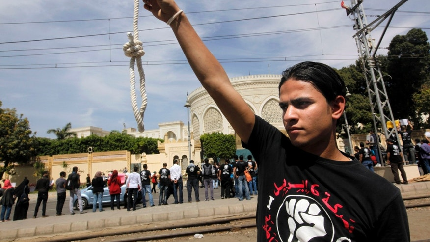 A member of Egypt's April 6 Youth Movement holds a noose in front of the presidential palace in Cairo, Egypt, Saturday, April 6, 2013. The group is rallying to mark its fifth anniversary and to protest against President Mohammed Morsi. (AP Photo/Amr Nabil)