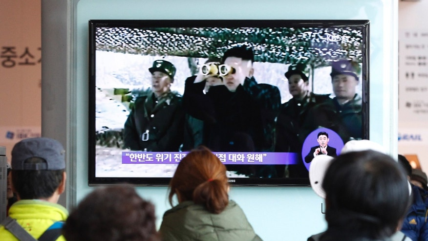 People watch a TV program showing North Korean leader Kim Jong Un at Seoul Railway Station in Seoul, South Korea, Sunday, April 7, 2013. South Korea's top military officer has put off a plan to visit Washington because of escalating tension with North Korea that have also led more than a dozen South Korean companies to halt operations at a joint factory complex in the North, officials said Sunday. (AP Photo/Ahn Young-joon)