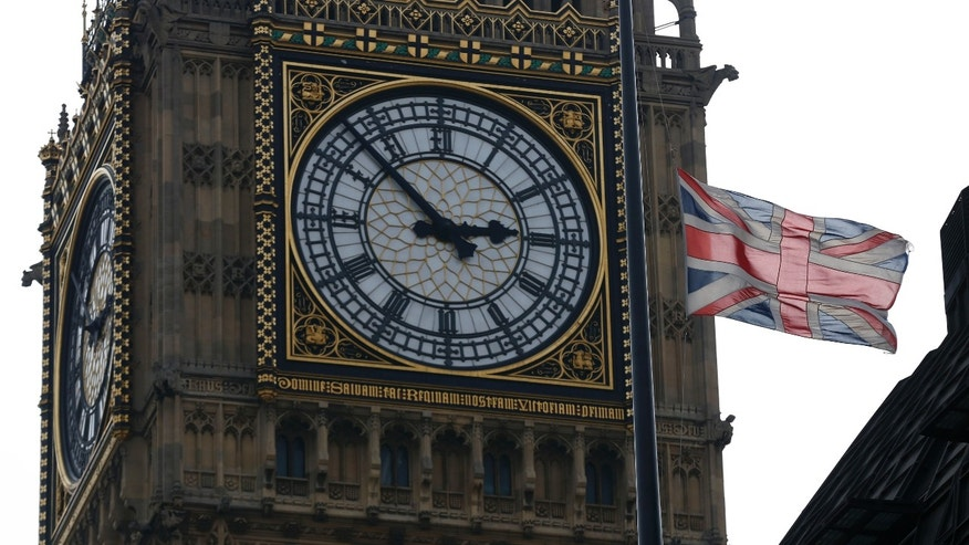 A British union flag flies at half-staff atop Portcullis House, backdropped by Big Ben's clock tower in London, Monday, April 8, 2013, in respect for former British Prime Minister Margaret Thatcher who died Monday following a stroke at age 87.  Flags were flown at half-staff at Buckingham Palace, Parliament and Downing Street in honour to the 87-year old Iron Lady, and Queen Elizabeth II authorized Thatcher to have a ceremonial funeral to be held at St. Paul's Cathedral in London with military honors. (AP Photo/Sang Tan)