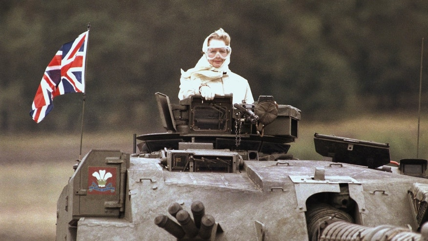 British Prime Minister Margaret Thatcher stands in a British tank during a visit to British forces in Fallingbostel, some 120km (70 miles) south of Hamburg, Germany. on Sept. 17, 1986. Thatchers former spokesman, Tim Bell, said that the former British Prime Minister Margaret Thatcher had died Monday morning, April 8, 2013, of a stroke. She was 87.(AP Photo/Jockel Fink)