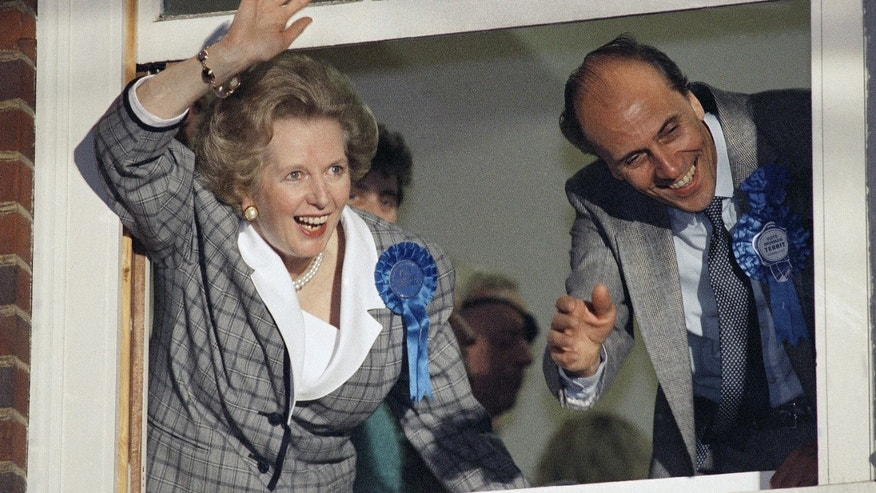 "FILE - In this June 12, 1987 file photo, British Prime Minister Margaret Thatcher waves to supporters from Conservative Party headquarters in London after claiming victory in Britain's general election. Ex-spokesman Tim Bell says that Thatcher has died. She was 87. Bell said the woman known to friends and foes as ""the Iron Lady"" passed away Monday morning, April 8, 2013. (AP Photo/File)"
