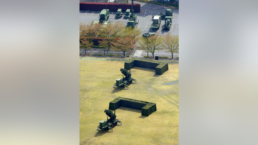 This aerial photo shows units of Japan Air Self-Defense Force's PAC-3s deployed at Defense Ministry in Tokyo Tuesday, April 9, 2013. Japan has deployed missile interceptors in key locations around Tokyo as a precaution against a possible North Korean ballistic missile tests. (AP Photo/Kyodo News) JAPAN OUT, MANDATORY CREDIT, NO LICENSING IN CHINA, HONG KONG, JAPAN, SOUTH KOREA AND FRANCE