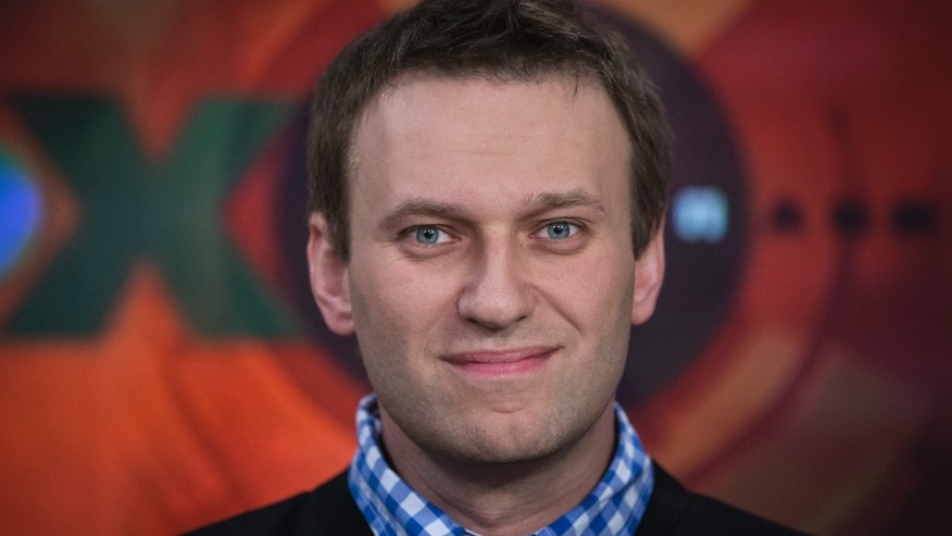 Russian opposition leader Alexey Navalny smiles as he speaks to a journalist during an interview in the Echo Moskvy (Echo of Moscow) radio station in Moscow, Russia, Monday, April 8, 2013. Navalny made his name as an anti-corruption whistleblower and spearheaded massive anti-Kremlin protests that followed the rigged parliament election in Dec. 2011. (AP Photo/Alexander Zemlianichenko)