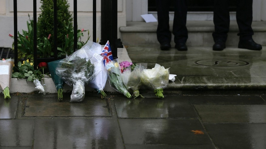 "Floral tributes are seen outside former British Prime Minister Baroness Thatcher's home in London Tuesday, April, 9, 2013. Margaret Thatcher, the combative ""Iron Lady"" who infuriated European allies, found a fellow believer in former US President Ronald Reagan and transformed her country by a ruthless dedication to free markets in 11 bruising years as prime minister, died Monday, April 8, 2013. She was 87 years old. (AP Photo/Alastair Grant)"