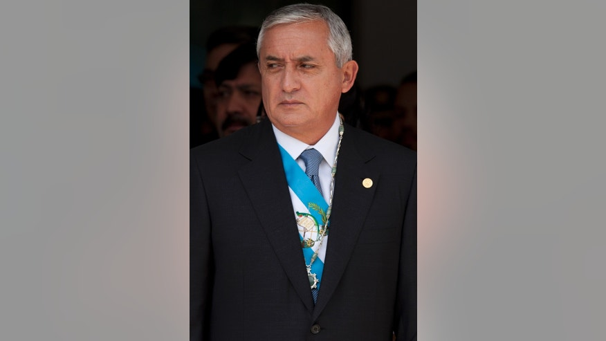 FILE - In this Jan. 15, 2012 file photo, Guatemala's President Otto Perez Molina attends a military ceremony in Guatemala City. President and former General, Perez Molina's name has come up before in connection with war crimes in the small Central American country's 30-year conflict. On Thursday, April 4, 2013, during the genocide trial of former dictator Efrain Rios Montt, Perez Molina was directly and publicly accused for the first time of ordering pillaging and executions by a protected witness. (AP Photo/Moises Castillo, File)